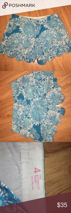 """Blue Scalloped Lilly Shorts Blue flower/dandelion print, scalloped edge. These have front and back pockets. """"The buttercup short"""" Purchased on posh but they didn't fit me. No damage.   Waist: 15.5 inches Hip: 19 Rise: 7.5  Inseam: 4.5 Lilly Pulitzer Shorts"""