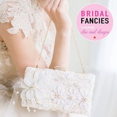 Lace Ivory Bridal Clutch with pearl flowers / hand beaded vintage flowers adorn this wedding clutch bag from the Cloe Noel Designs Couture Collection / perfect bridal accessory for evening weddings / as seen on Brenda's Wedding Blog for Creative Wedding Ideas www.brendasweddingblog.com