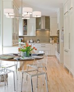 I like the variety of cabinet types, the hidden refrig, the softness of the granite.  I also LOVE the chairs and light fixture.