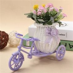 Do you have an old bicycle rusting away in your shed? Do you like to give it a new life as a yard decoration? Here are beautiful DIY ideas that can help to turn your bike into a stunning centerpiece for your garden Storage Containers, Storage Baskets, Bright Paint Colors, Tricycle Bike, Old Bicycle, Bright Paintings, Flower Holder, Flower Stands, Container Flowers