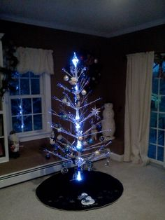 White tree with blue decorations