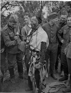 German soldiers from an Einsatzgruppen (Mobile Death Squad) torment a Jew who was caught in prayer.  Men from these squads were infamous for their psychopathic brutality and willingness to engage in mass murder without qualm or conscience.  Once in the clutches of an Einsatzgruppen, a quick death was for the fortunate.  Humiliation, degradation, and torture before death was the most common fate.