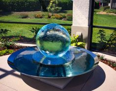 Allison Armour's now famous Aqualens Sphere Water Fountain is the perfect addition to your garden or outdoor space. View gardens with water features here. Backyard Water Fountains, Garden Fountains, Water Globes, Water Features In The Garden, Home Landscaping, Private Garden, Driveway Ideas, Patio Ideas, Yard Ideas