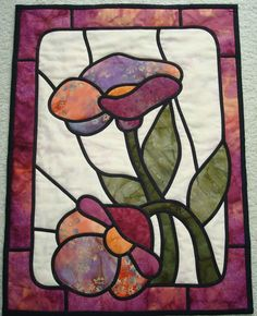 A stained glass wall hanging made quite a few years ago. From a Dover book stained glass pattern.