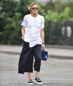 Fashion forward: Olivia Palermo donned an asymmetrical, white blouse as she…