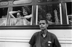 "Civil Rights Activist Julian Bond  Civil rights activist Julian Bond stands next to a bus full of young people taking part in the Congress of Racial Equality (CORE) training session. The session then allowed them to participate in the ""Freedom Summer"" campaign, which registered new voters in the Deep South.    © Steve Schapiro/Corbis"