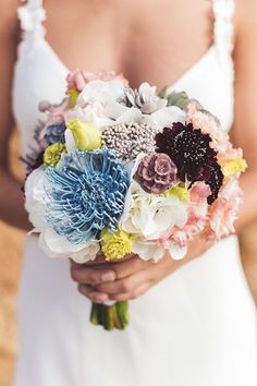 Featuring a blue protea, this bouquet was inspired by the color palettes of several famous Spanish painters. | Photo by The Love Studio