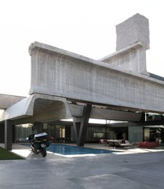 Hemeroscopium House_Antón García Abril, a Madrid architect, has designed a house that is built out of infrastructure pieces -- three giant concrete I-beams, two concrete segments from an irrigation canal and two steel girders - anchored on top by a 20-ton piece of granite