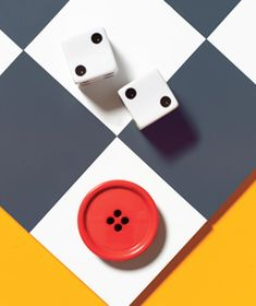 Button as boardgame piece- would be fun to create a whole game out of odd-and-end trinkets that are floating around the house