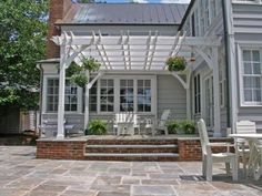 outdoor pergola design used on a bluestone patio. This pergola was featured on the Nate Berkus show in diy modern screen wall Restaurant Patio, Pergola Cost, Backyard Pergola, Gazebo, Pergola Screens, Vinyl Pergola, Corner Pergola, Porches, Ideas