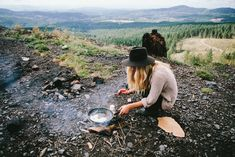 Camping in the wilderness in a cute wide brimmed floppy hat