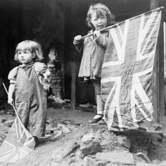 Two small girls wave their flag amid rubble in the London district of Battersea on May 8th 1945 (My Great Grandmother was bombed out of three houses in Battersea in WW2, the last time my Mum found her sitting in the pub with rubble in the brim of her hat!) She lived to 103!!
