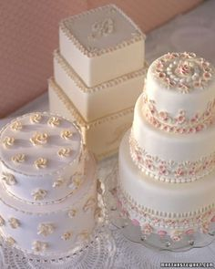 """These masterly cakes, made by Ohio baker and Weddings contributing editor Wendy Kromer, have romantic seaworthy roots: They are styled after """"sailors' valentines"""" -- keepsake boxes, decorated with intricate shell patterns, that 19th-century mariners gave as gifts to their beloveds. The originals inspired our mosaics of gum-paste shells arranged in concentric circles, rosettes, and monograms."""