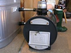 Chofu - wood fired hot tub heater connected to a galvanized stock tank.