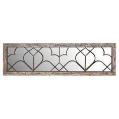 """Wood and metal mirror decor with a lattice motif and distressed detail.  Product: Wall mirror décorConstruction Material: Wood, metal and mirrored glassColor: Weather naturalDimensions: 18"""" H x 63"""" W x 1"""" D"""