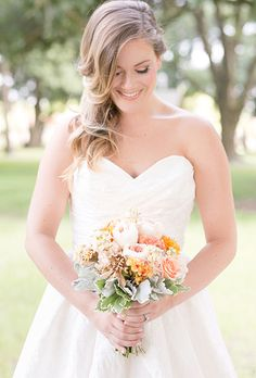 A mixed posy with blush garden roses, greenery, and dusty miller by @windermereflwrs | Brides.com