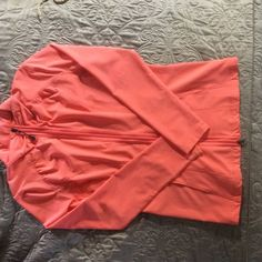LIGHT ACTIVEWEAR JACKET Light activewear jacket. Slightly used but in good condition. Orange/Coral in color.  Full zipper and pockets. 92% Polyester/8% Spandex. RYKA Jackets & Coats