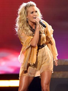 Carrie Underwood!!!!! Love her. She has the best songs,videos,clothes,and everything else! :)