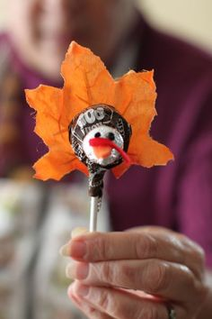 "Tootsie roll pop and Hershey's kiss with ""leaf"" to make a turkey"