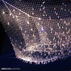 """2009 Installation by the great Ingo Maurer: """"Lacrime Del Pescatore"""" (tears of the fishermen) adds 300 crystal drops to 3 fisherman's nets."""