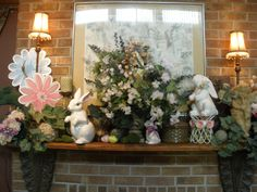 Finally got all my Easter decorating finished! Easter Mantel 2012. You can barely see the Bird House in the Arrangement. I love the little wire plant stand with roses and I have great collection of paper mache and ceramic rabbits.