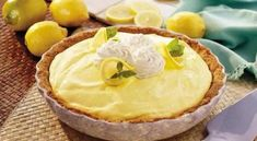 Fluffy Triple Lemon Pie - Sweet and tart, this cool pie tasted like summer all year round. Lemon Desserts, Lemon Recipes, Pie Recipes, Just Desserts, Delicious Desserts, Dessert Recipes, Yummy Food, Yummy Treats, Sweet Treats