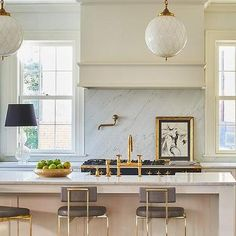 Long Cream Kitchen Island with Gold and Gray Counter Stools