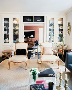 Living Room Eclectic Photo - A pair of chairs in front of white built-in china cabinets