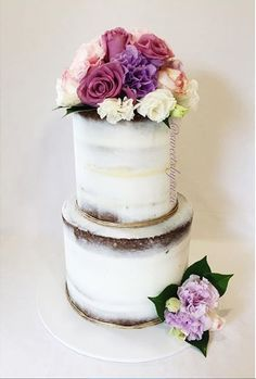 Semi naked engagement cake with fresh florals made by Sweetsbysuzie