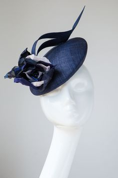 Handmade in our London studio.Pinopok cocktail hat with handmade silk flowers. Ivory, Navy Blue and Royal Blue flowers.Secured with a comb and elastic.Sent free within the UK. Includes a Black Millinery Hats, Fascinator Hats, Fascinators, Headpieces, Simple Dress Styles, Royal Blue Flowers, Silk Flowers, Cocktail Hat, Fancy Hats