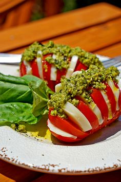 This is a new take on a classic - the Caprese Salad. Taking the hasselback potato cutting technique makes this a perfect individual snack. With fresh mozzarella and pesto wedged inside each slice.