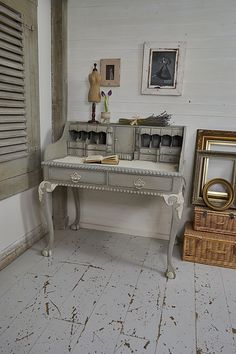 What a fabulous find! This French style writing desk/bureau has a stunning look and 2 additional secret drawers underneath! We've kept the desk in a real shabby chic style with plenty of aging for that rustic charm! Painted in Annie Sloan Paris Grey & Old White. http://www.thetreasuretrove.co.uk/tables/french-style-vintage-writing-deskbureau