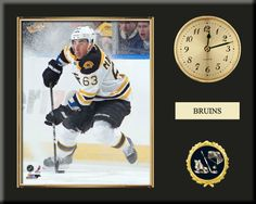 One 8 x 10 inch Boston Bruins photo of Brad Marchand inserted in a gold slide-in frame and mounted on a 12 x 15 inch solid black finish plaque.  Also features a 3-inch Arabian gold-faced clock, a customizable nameplate* and a 2-inch hockey medallion with a gold base.  $59.99 @ ArtandMore.com