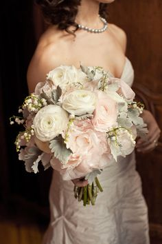 I love this combination of flowers - white ranunculus, lily of the valley, light pink garden roses and silver leaf giving the bouquet a timeless look.