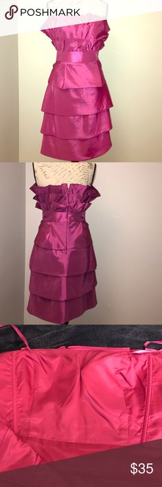 Max and Cleo strapless magenta ruffle tiered dress Max and Cleo. Size 8. Magenta. Polyester / nylon blend. Gorgeous ruffle detail. Tiered layer look. Lined. Max & Cleo Dresses Strapless