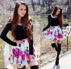 Long sleeve black shirt and floral skirt with thigh-high black socks! Love this outfit!