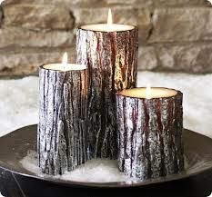tree trunk candles - Google Search  Add a mason jar with evergreens, snow to the plate, and some purple and blue.