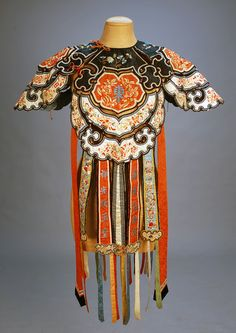 Chinese wedding collar, c. early 20th century; Silk cord, beads, streamers and appliques, lined with blue silk