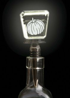 "Barware, Pumpkin,LED Etched Wine Stopper,Metal and Glass,1.5x4.5 Inches by Cypress Home. $16.88. The size is: 1.5""x4.5"". Packaged in a beatiful gift box.. Metal and Glass. Clear glass top with 3-D laser etched letter. Nickel-plated brass stopper with rubber rings.. Don't let your good wines go bad! Save them for later with this stunning winestopper, that is sure to turn heads."