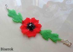 bracelet de perles avec un coquelicot rouge