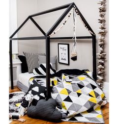 Perfect for your monochrome super hero boys room, this modern quilt bring a pop of color. Handmade by NotSewStrange.