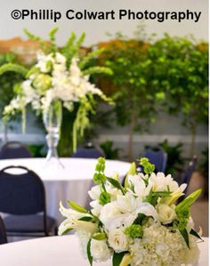 Tall and low green and white centerpieces