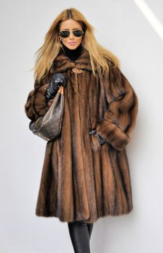 Model in Tourmaline EMBA hooded mink coat by Christian Dior photo