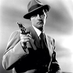 Robert Mitchum Posed in Tuxedo With Pistol Photo by Movie Star News Hollywood Icons, Golden Age Of Hollywood, Vintage Hollywood, Hollywood Stars, Classic Hollywood, Hollywood Men, Classic Movie Stars, Classic Movies, Cthulhu