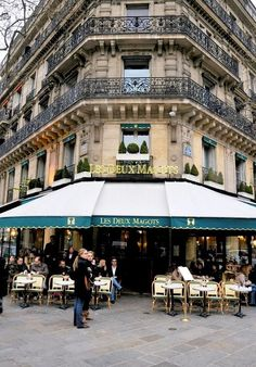 Les Deux Magots, Paris: The name originally belonged to a fabric and novelty shop at nearby 23 Rue de Buci. The shop sold silk lingerie and took its name from a popular play of the moment entitled Les Deux Magots de la Chine (Two Figurines from China). Paris France, Oh Paris, France Cafe, Montmartre Paris, I Love Paris, Oh The Places You'll Go, Places To Travel, Places To Visit, Paris Travel