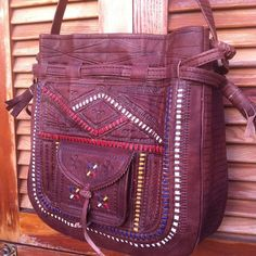 Gorgeous handcrafted bag from Morocco. A colorful combination of tooled, embossed, & woven leather make this bag unique even among these types of bags.