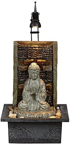 """Namaste Buddha 11 1/2"""" High Indoor Table Fountain - Add serenity to a space with this indoor tabletop fountain depicting a Buddha sitting amongst rocks. Perfect for meditating, this peaceful design comes with a light for easy illumination. Constructed of fiberglass, this tabletop fountain is lightweight and easy to move.- 11 1/2"""" high x 8 1/4..."""