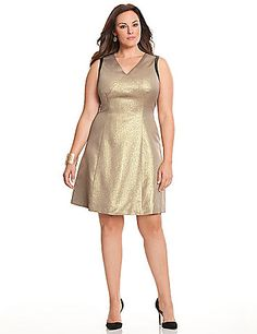 GIRLS NIGHT OUT!! - DKNYC's shimmering golden dress. Soft, stretch ponte knit pieced with faux leather for a touch of rock & roll edge, this sexy fit & flare silhouette flatters with a V-neck and body-contouring seams. Sleeveless. Back zipper closure.