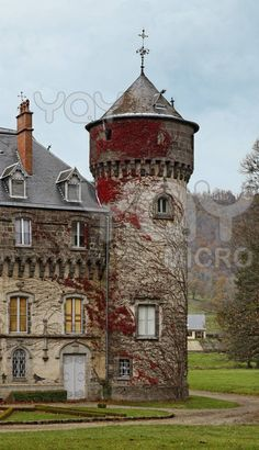 Autumn image of one of the towers of Sedaiges castle.This castle was built in the 12th century and is a unique example of Troubadour architecture of the 19th century.It is located in Auvergne province in south -central France.
