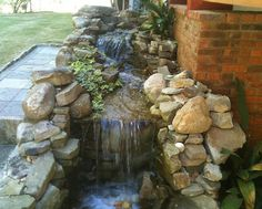 """Gorgeous waterfall created byUnique Outdoor Concepts. We can design any outdoor environment into your own """"personal piece of paradise!"""" This is just one example of the work we do."""